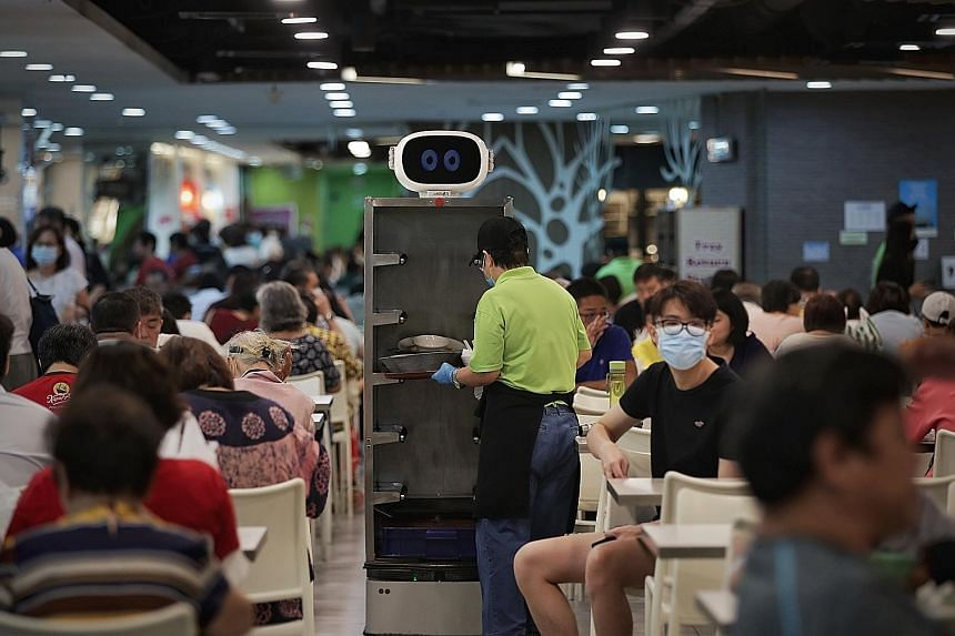 A Smart Tray Return Robot at Gourmet Paradise in Toa Payoh. A tray return station at Bukit Merah Central Food Centre. The Kopitiam @ Our Tampines Hub foodcourt.