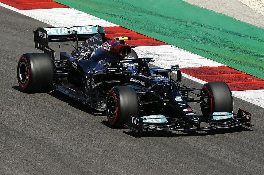 Finnish driver Valtteri Bottas (far right) taking his Mercedes (above) to a 17th career pole position yesterday at the Portuguese GP, 0.007sec ahead of Lewis Hamilton.