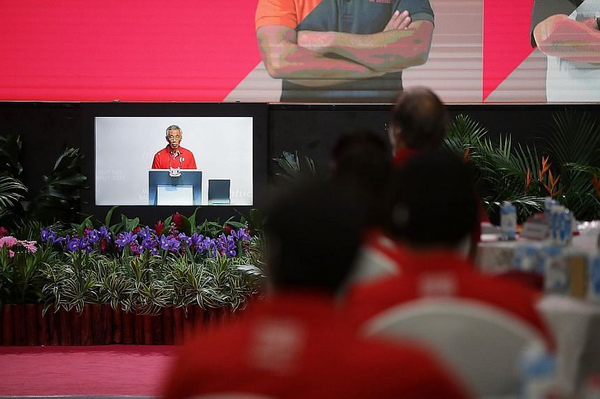 Prime Minister Lee Hsien Loong seen here delivering his keynote address to unionists at D'Marquee@Downtown East during the hybrid May Day Rally yesterday.