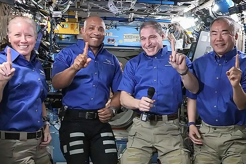 (From left) Shannon Walker, Victor Glover, Michael Hopkins and Soichi Noguchi on the International Space Station.