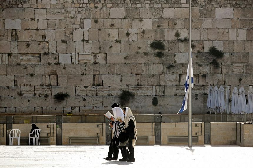 The Israeli national flag was lowered to half-mast on May 2, 2021, as the country observes a day of mourning after dozens were crushed to death in a religious festival stampede.
