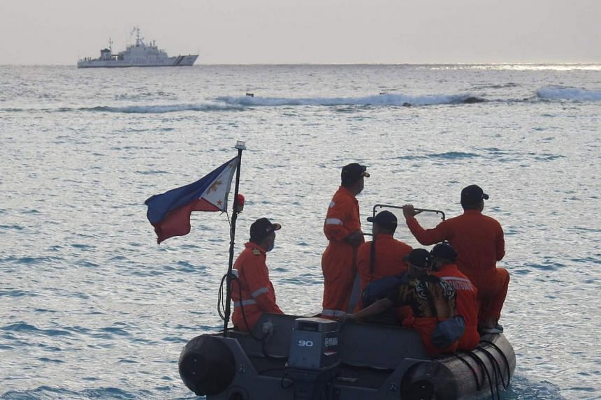Philippine Coast Guard personnel conducts a maritime exercise in the disputed South China Sea, on April 24, 2021.