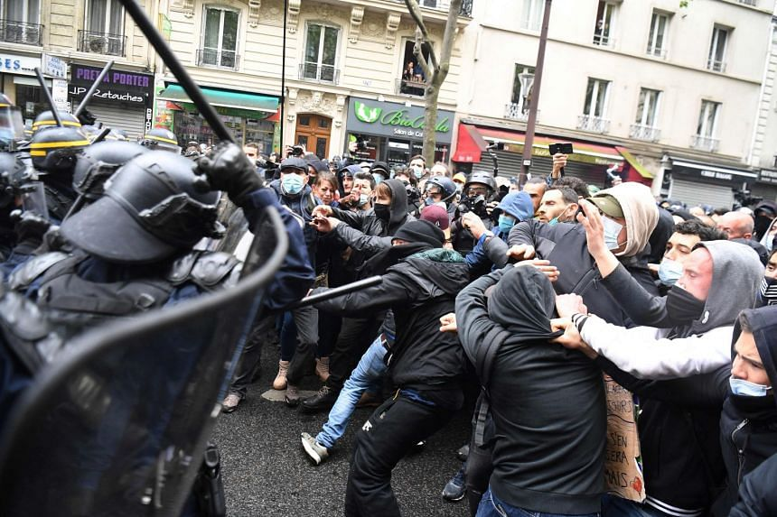 Protesters clash with police during the annual May Day rally in Paris on May 1, 2021.