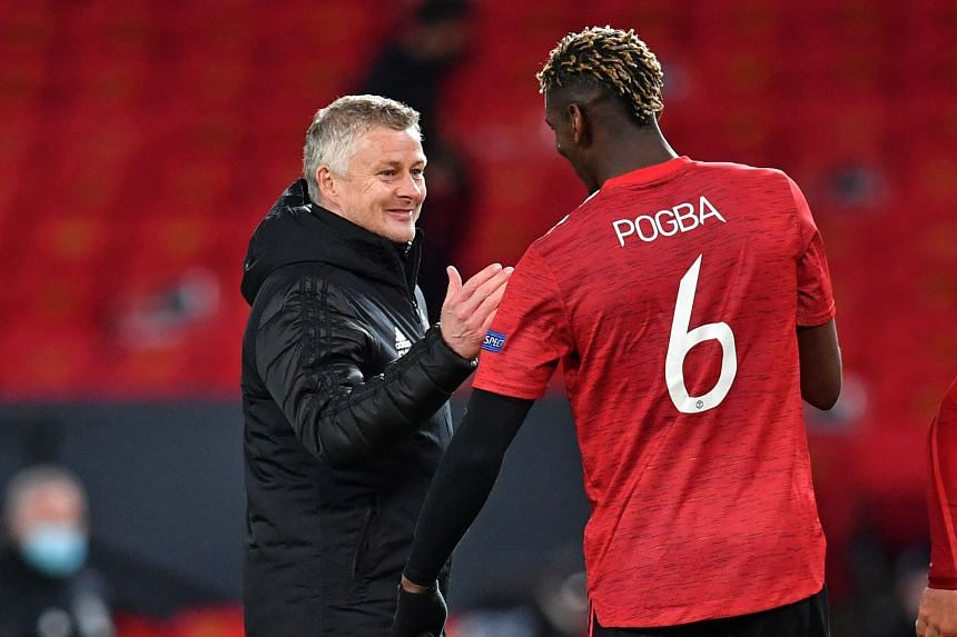 Solskjaer congratulates Manchester United's French midfielder Paul Pogba after the UEFA Europa League semi-final in Manchester, England, on April 29, 2021.