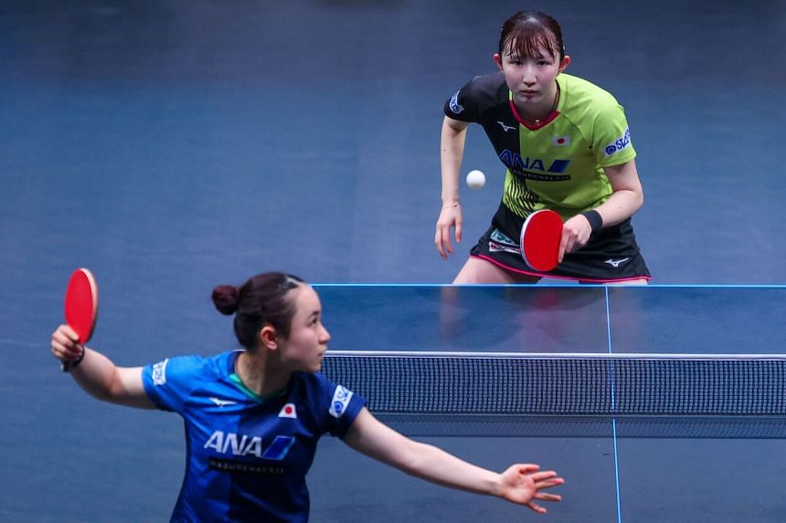 Japan's Hina Hayata (right) competes with Japan's Mima Ito during the finals of the women's singles of the World Table Tennis (WTT) Middle East Hub in the Qatari capital Doha, on March 6, 2021.