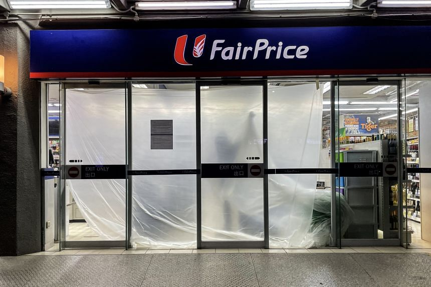 The FairPrice outlet in Kitchener Complex being cleaned on April 30, 2021. It was one of the places visited by individuals with Covid-19.