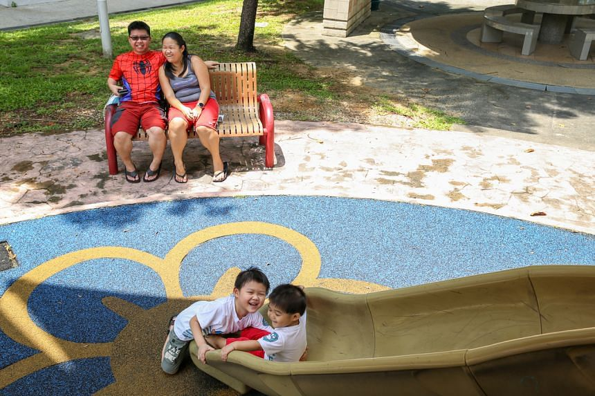 Mr Michael Lim and Ms Debbie Liew watching their children, Jasper (left) and Jared (right) play at the playground on April 18, 2021.