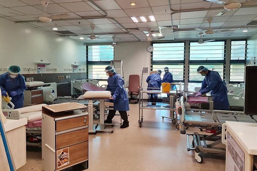 Housekeeping staff thoroughly disinfecting Ward 9D of Tan Tock Seng Hospital.