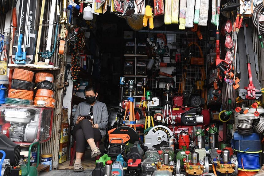A woman waiting for customers at a shop in Hanoi, Vietnam. Pledges of foreign capital in the country rose more than 18 per cent to $13.4 billion during the first quarter of this year, from a year earlier.