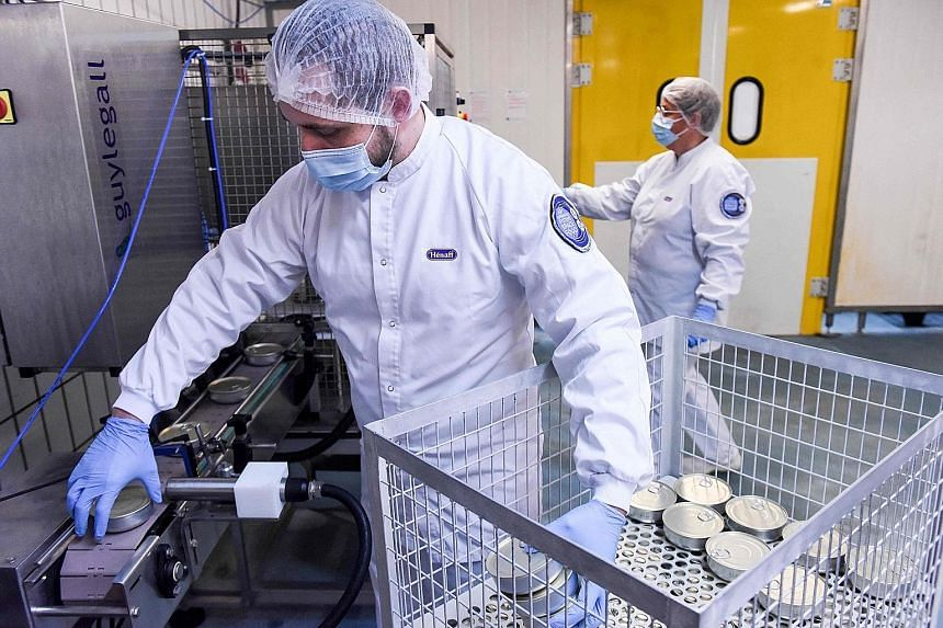 Employees at the factory canning space food for Mr Pesquet. The astronaut will not be dining on lobster and beef burgundy every day. These meticulously prepared dishes are intended for celebrations of special occasions like birthdays, with enough ser