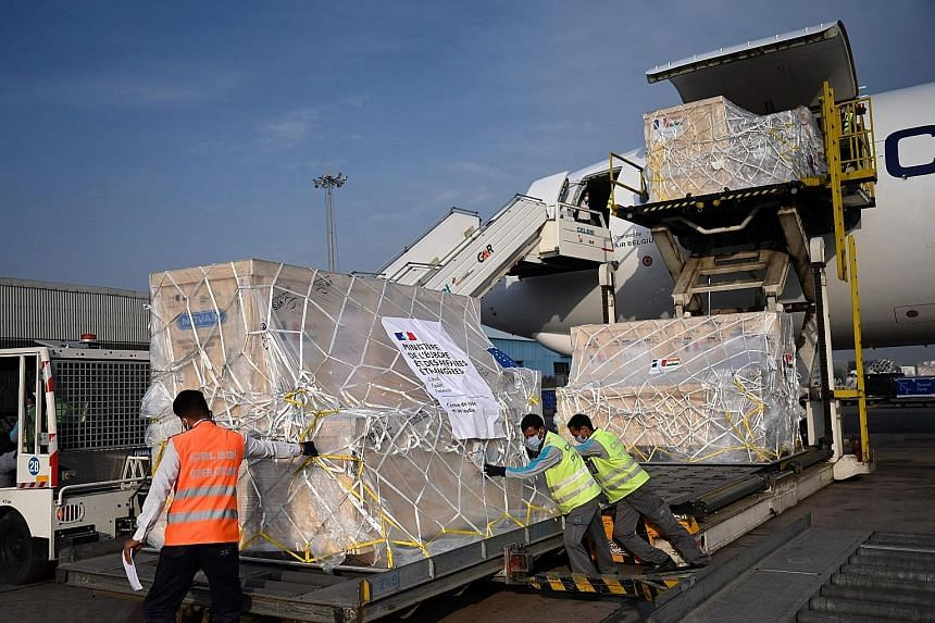 Workers unloading medical supplies from France at the Indira Gandhi International Airport in New Delhi yesterday. French Ambassador Emmanuel Lenain says his country wants to show solidarity with India.
