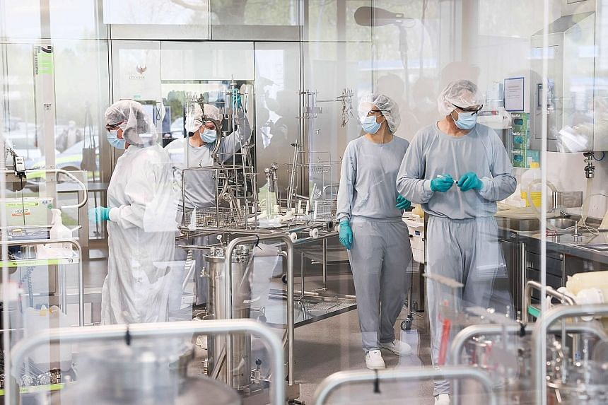 Employees in Allergopharma's plant near Hamburg, Germany, working on production of the Pfizer-BioNTech Covid-19 vaccine last month. The Covid-19 health pandemic has exacerbated and, in many instances, accelerated challenges familiar to media owners,
