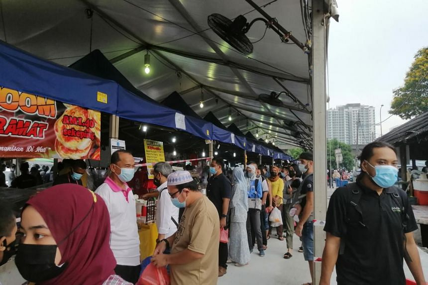 Crowds queue closely at the Ramadan bazaar in Kuala Lumpur, on April 16, 2021.
