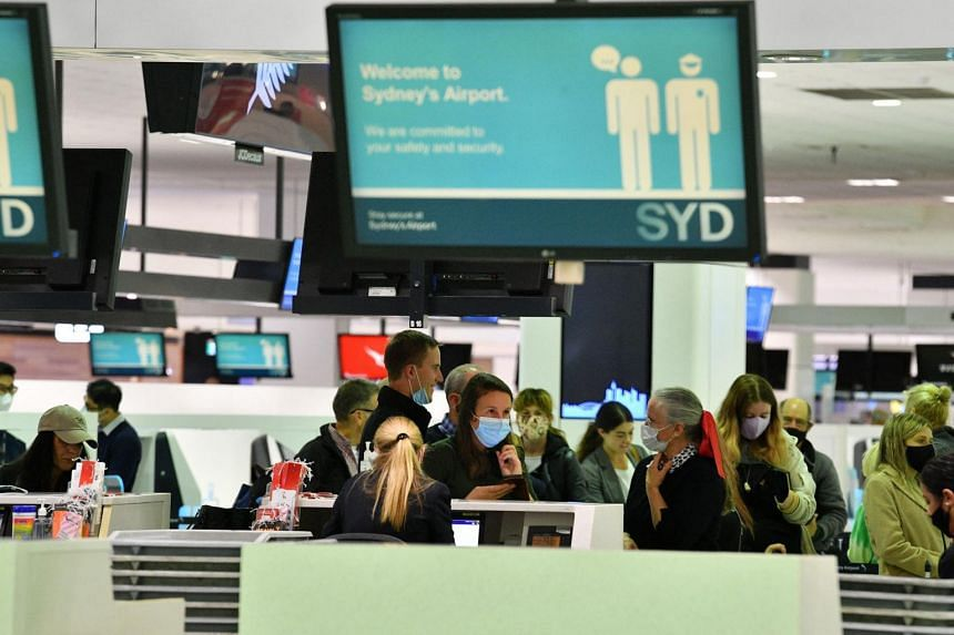 There are fears Australia's quarantine system will buckle with more returning travellers testing positive.