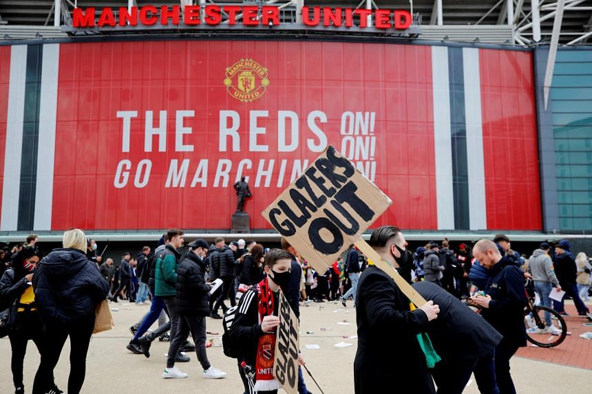 Fans protest against Manchester United's owners outside the stadium, on May 2, 2021.
