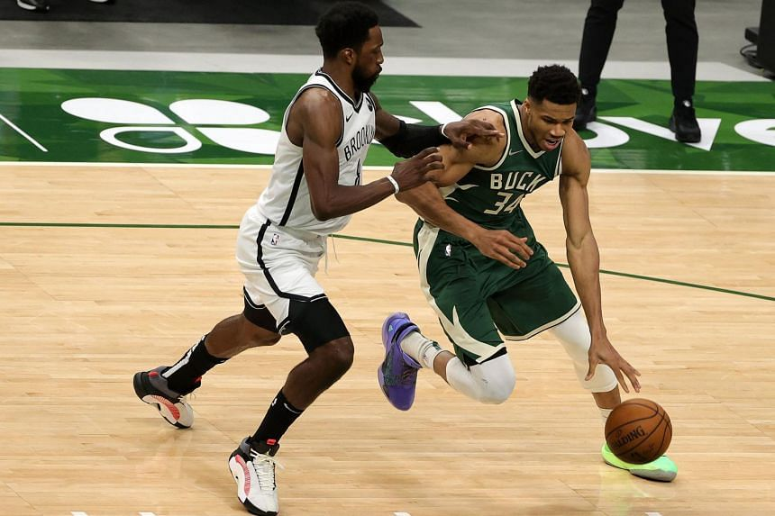 Giannis Antetokounmpo (in green) finished just three points short of his career high.