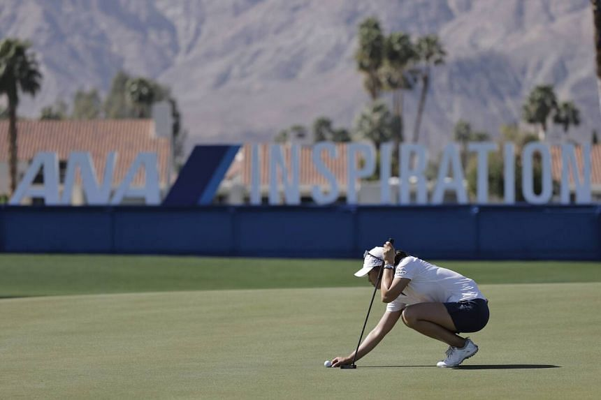 Danielle Kang lines up her putt during the ANA Inspiration championship at Mission Hills Country Club in California, on April 2, 2021.