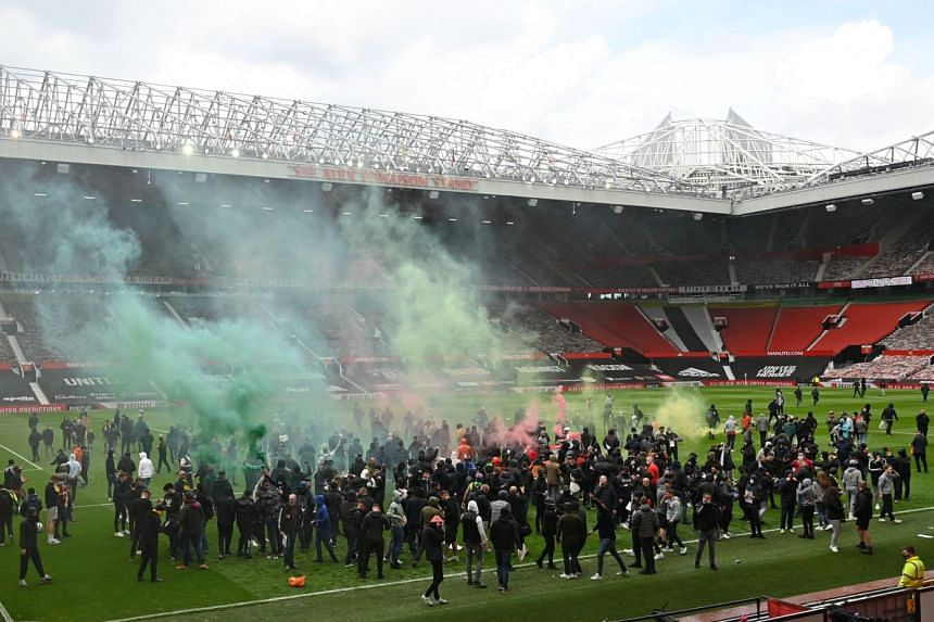 Supporters protest against Manchester United's owners, inside Old Trafford stadium, on May 2, 2021.