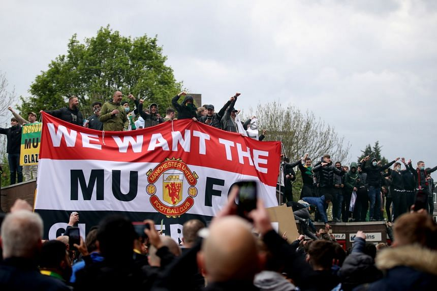Manchester United fans protest against their owners in Manchester, Britain on May 2, 2021.