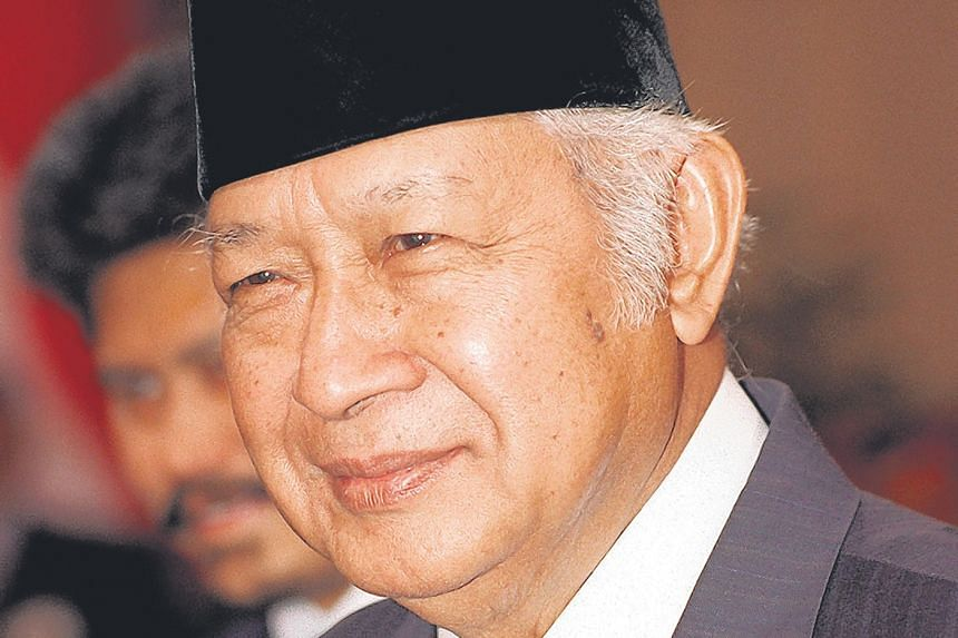 A Singaporean management consulting company is suing the children of Indonesia's former president, Suharto.
