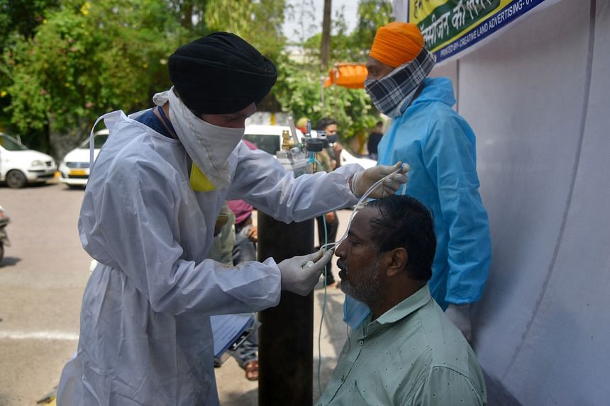 A suspected Covid-19 patient receiving oxygen at a Sikh shrine, on May 1, 2021.