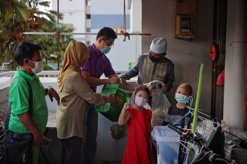 Volunteers deliver food bentos and cookies to resident Abu Talib Jaffar on May 2, 2021.