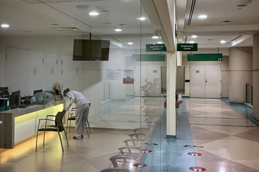 An employee is seen disinfecting seats in the Endoscopy Centre of Tan Tock Seng Hospital on Apr 29, 2021.