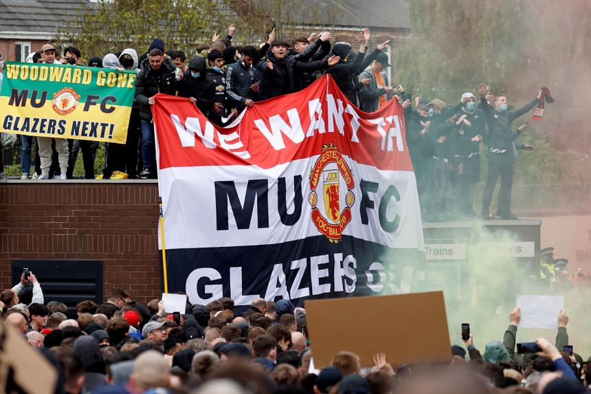 Supporters protest against Manchester United's owners, outside Old Trafford stadium, ahead of the Premier League match against Liverpool, on May 2, 2021.