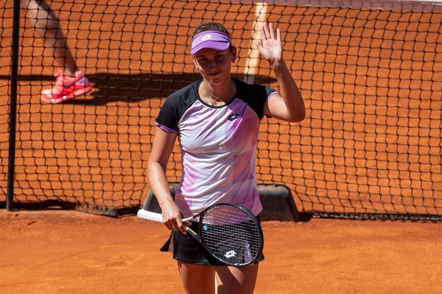 Elise Mertens celebrates after winning her third-round match against Simona Halep of Romania.