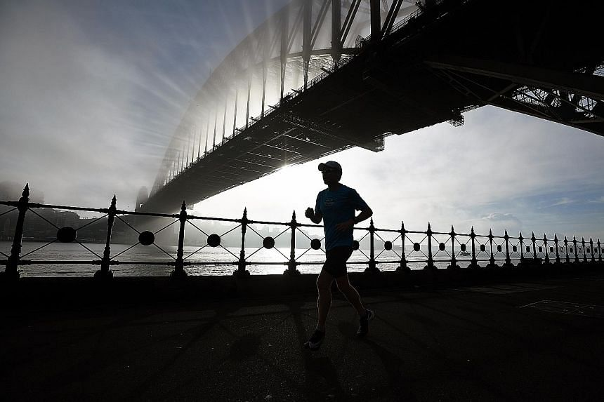 """The Sydney Harbour bridge, enveloped by fog and bush fire smoke haze, on Sunday morning. The fire services carry out """"hazard reduction burning"""" regularly to clear forest floors of debris that can fuel wildfires, but were forced to scale back plans as"""
