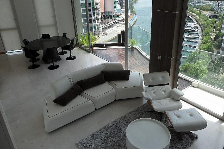 Above: Mr Nelson Loh and his wife paid $4.65 million for a 3,218 sq ft triplex penthouse at The Oceanfront in Sentosa Cove which has three bedrooms, an entertainment room and a pool. It is on the market for $4 million. Below: The couple co-own a 9,04