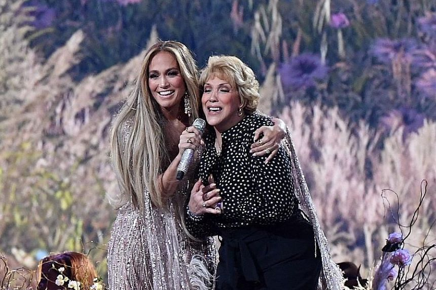Singer-actress Jennifer Lopez said she spent Christmas without her mum, Ms Guadalupe Rodriguez (both above), for the first time due to the pandemic - before bringing her onstage for a singalong of Sweet Caroline.