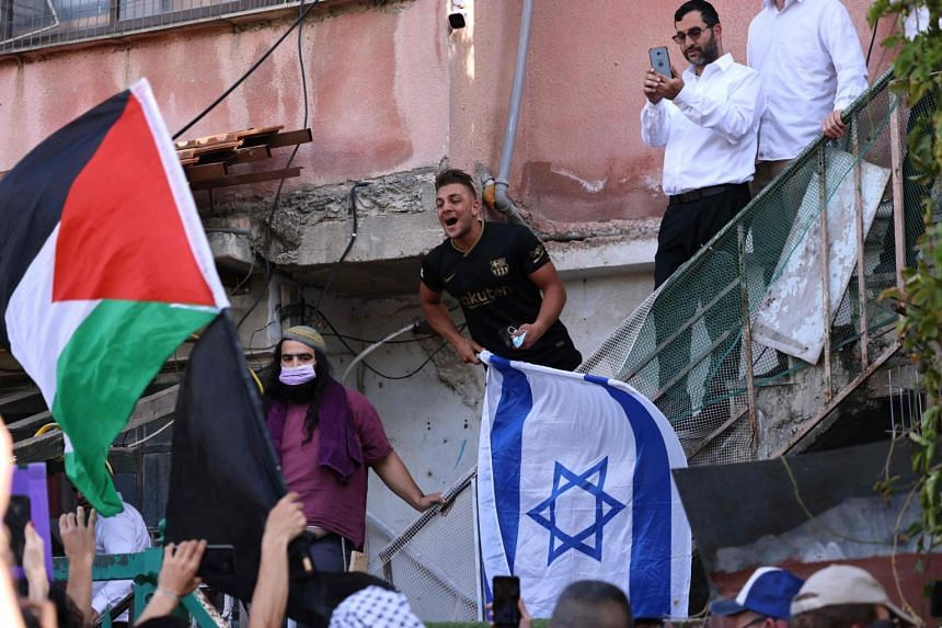 Israeli settlers in Sheikh Jarrah reacting as Palestinian and Israeli activists chant slogans in east Jerusalem on April 16, 2021.