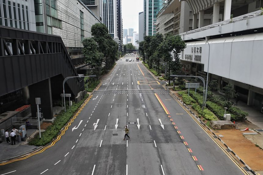 An empty Shenton Way on the first day of the circuit breaker on April 7, 2020. There is no need to impose such measures at the moment, said Minister Lawrence Wong.