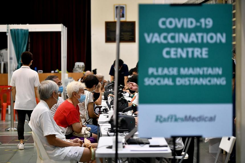 People waiting to receive their Covid-19 vaccination at Hong Kah North Community Club on March 17, 2021.