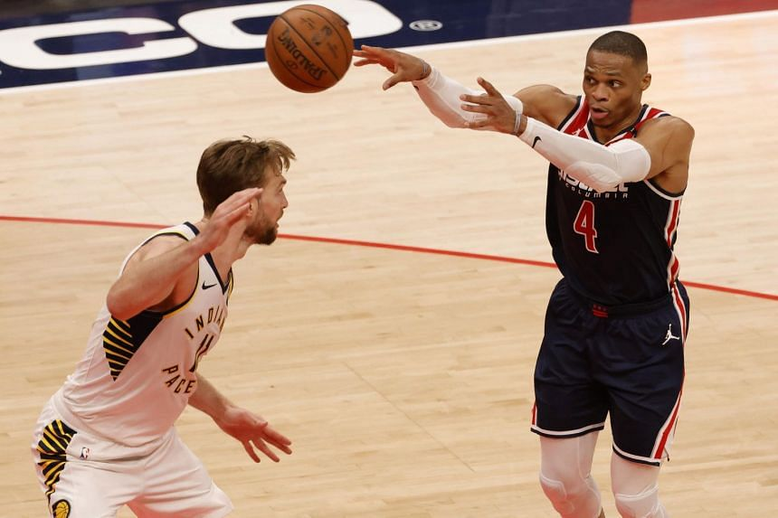 Washington Wizards guard Russell Westbrook (4) passes the ball in the second quarter of the game at Capital One Arena in Washington, on May 3, 2021.