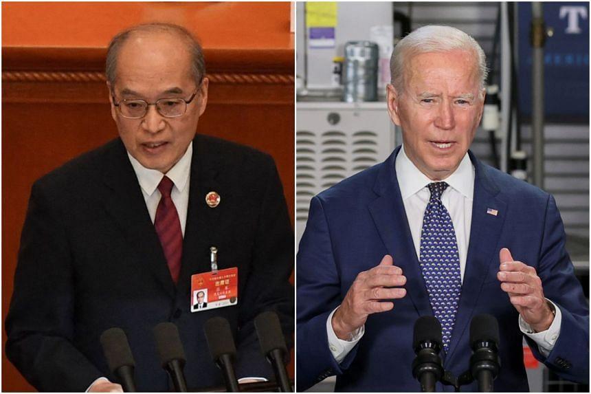Chinese Ambassador Zhang Jun (left) and US President Joe Biden.