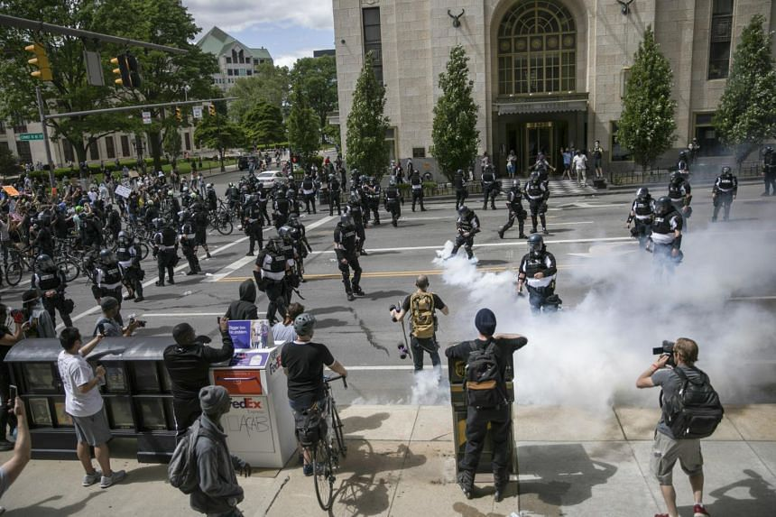 Police send tear gas into crowds of protesters in Columbus, Ohio on May 30, 2020.