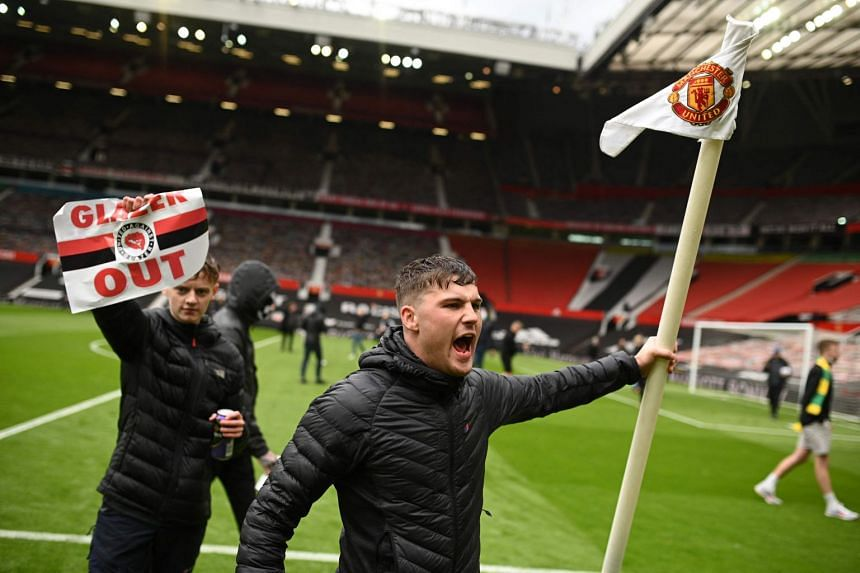 Manchester United fans protest against the club's owners on the pitch of Old Trafford stadium, on May 2, 2021.