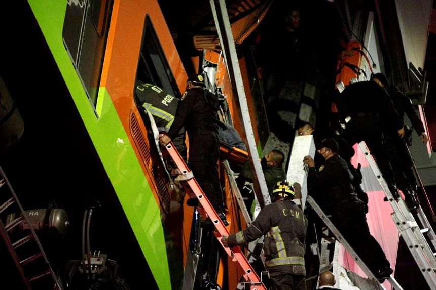Rescuers work at a site where an overpass for a metro partially collapsed at Olivos station in Mexico City, on May 3, 2021.