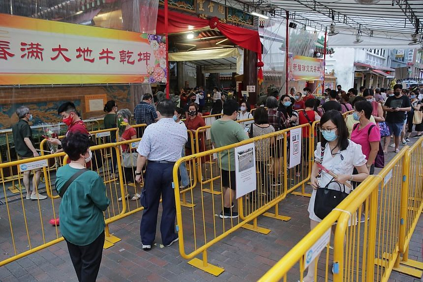 Devotees queuing to enter Kwan Im Thong Hood Cho Temple in Waterloo Street on Feb 15 after it closed on Chinese New Year's Eve a few days earlier to prevent crowding. The temple will be closed on Vesak Day on May 26.