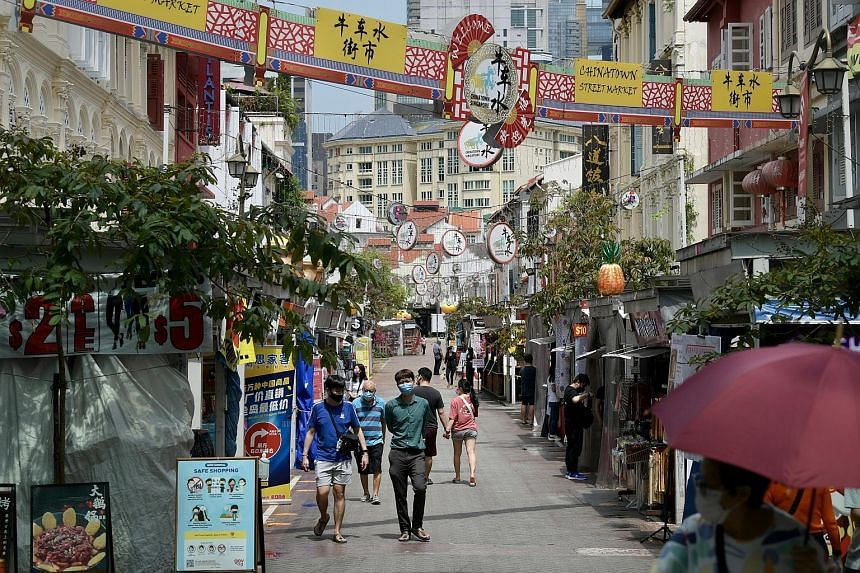 Pedestrians in Chinatown last month. Based on the number of unlinked cases and the results of Singapore's sentinel surveillance programme, the current situation is more like the early phase of the outbreak in February and March last year, when Singap