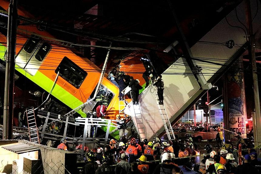 Rescuers at the site where an overpass for a rail line had partially collapsed with train cars on it at Olivos station in Mexico City on Monday.