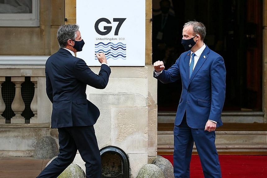 UK Foreign Secretary Dominic Raab (right) greeting US Secretary of State Antony Blinken on his arrival at Lancaster House in London yesterday for the Group of Seven foreign ministers' meeting.