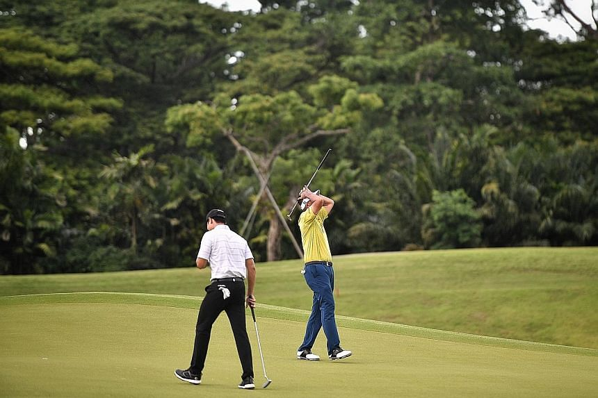 Left: Gregory Foo (in white and above) and Mardan Mamat during the final round of the Singapore Pro Series Invitational yesterday. Foo shot his best-ever score of eight-under 64 for a 139 total to beat childhood hero Mardan by two shots and clinch th