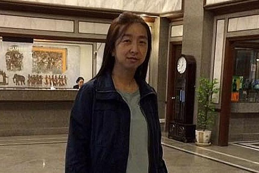 Ms Wong Siew Yuen (above) was killed after an accident involving a shuttle bus along Nanyang Drive (left) on Monday night.