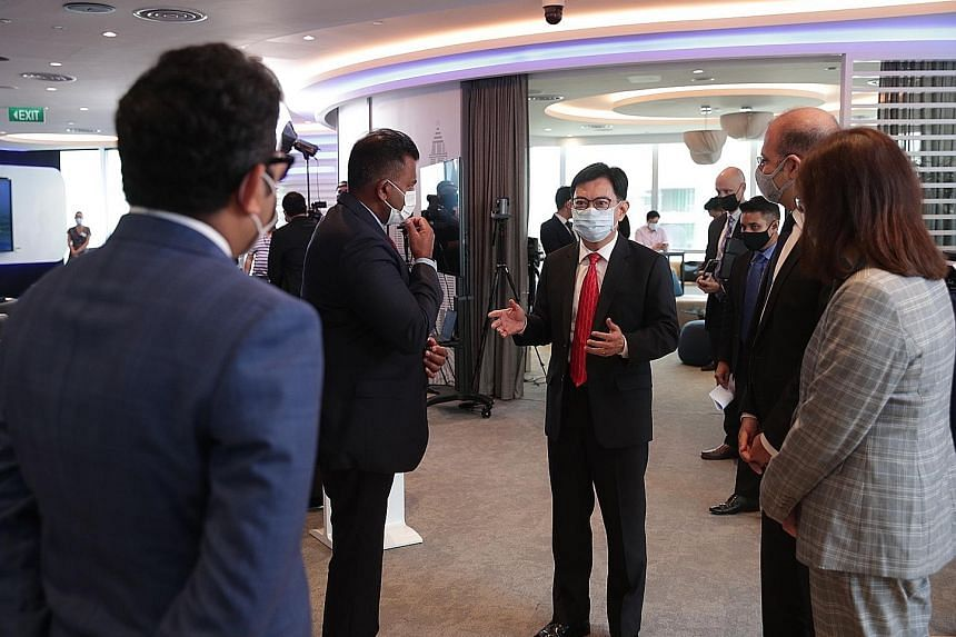 Deputy Prime Minister Heng Swee Keat interacting with guests during the launch of iLab 2021, a virtual innovation festival organised by American consumer goods giant Procter & Gamble in partnership with the Economic Development Board.