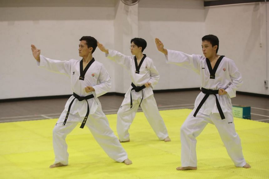 (From left) Donald Oh, Benjamin Koh and Teh Wei Feng from Anderson Serangoon Junior College competing in the team event at the A Division Taekwondo (Poomsae) Championship on May 5, 2021.