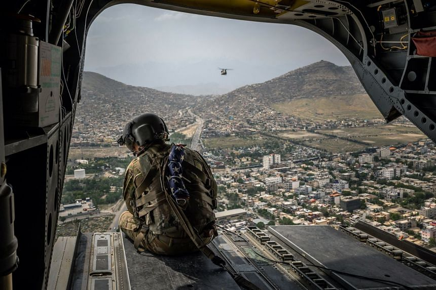 A US soldier aboard a Chinook helicopter over Kabul, Afghanistan, on May 2, 2021.
