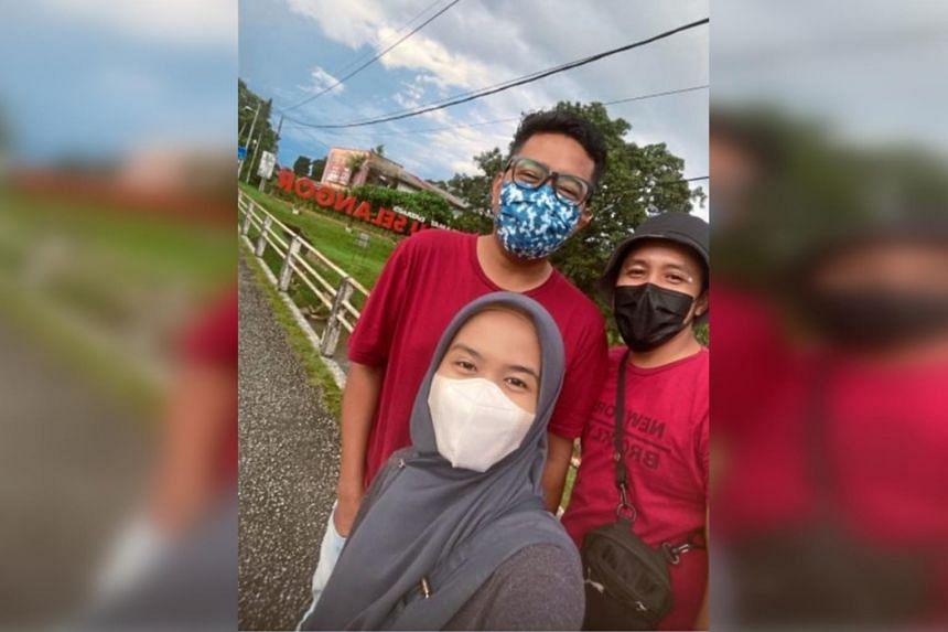 Amir Affendi with his siblings at the Tanjung Malim-Ulu Bernam border on May 3.